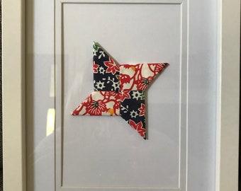 White framed border origami ninja star