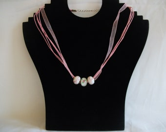 Ribbon and cord necklace with glass beads