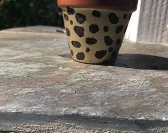 Hand painted leopard terra cotta pot
