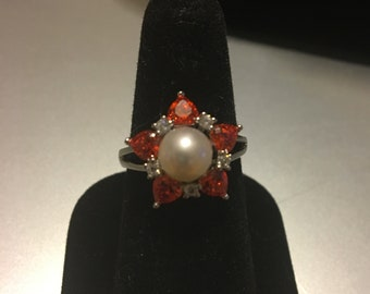 Pearl and gemstone ring.