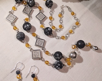 Necklace and earrings set with amber czech crystals