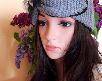 Exclusive knitting headband with elegant brooch