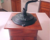 Ornate Cast Iron and wood Coffee Grinder Circa. 1950s