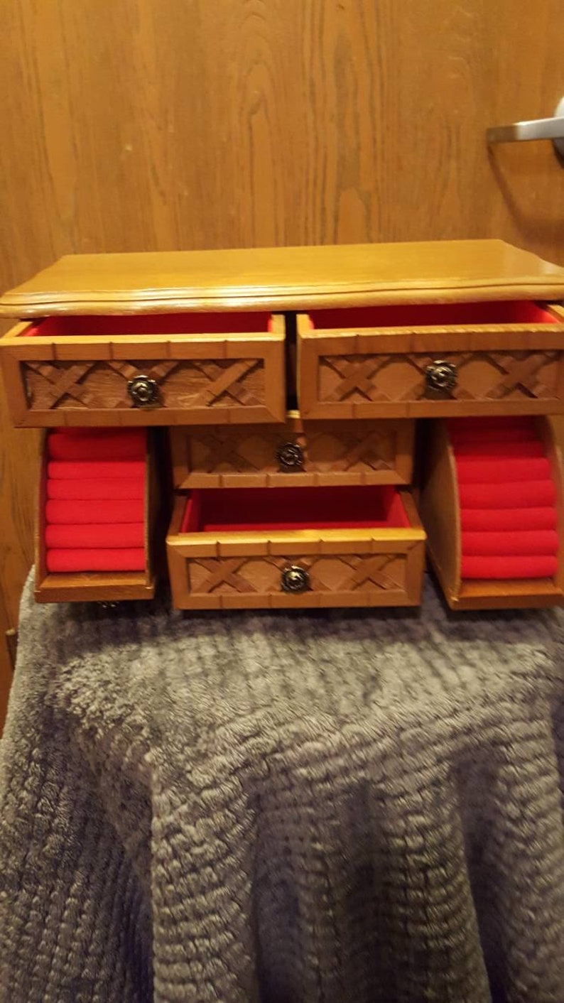 6 drawer wooden Jewelry Box with red felt inserts.