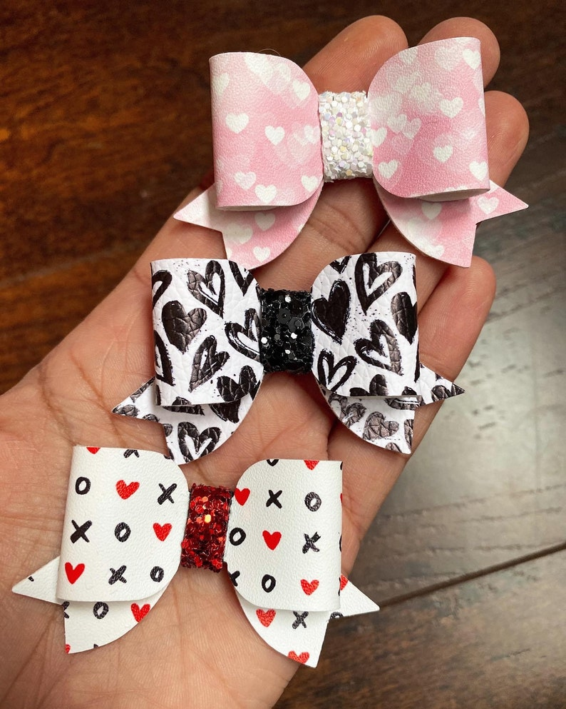 Adorable pink and white watercolour heart faux leather and chunky glitter bows pink and white heart Valentine\u2019s pigtail bows or headbands.