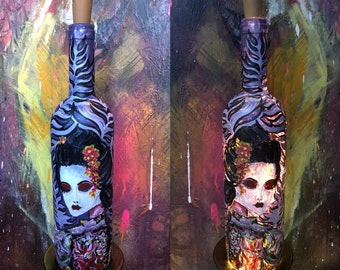 Handmade painted bottles with acrylic paint