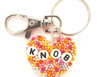 Bespoke heart shaped shiny resin keyring with multi coloured baubles.