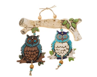 Two owl's Mobile On a wide branch