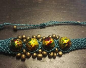 Bracelet macramé decorated with Golden beads.