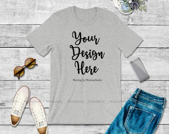Download Free Bella Canvas 3001 Athletic Heather Gray Unisex Women T-Shirt Mock Up, Grey Shirt Flat Lay Tee Apparel Youth Shirt Wood Background Mockup PSD Template