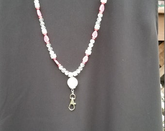 Pink and white suede lanyard.