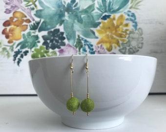 Dangle earrings with green felted wool bead