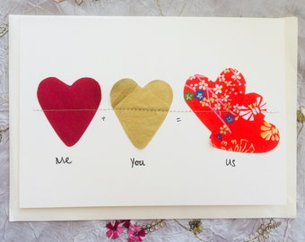 """Hearts on gold string """"You & Me = Us"""""""