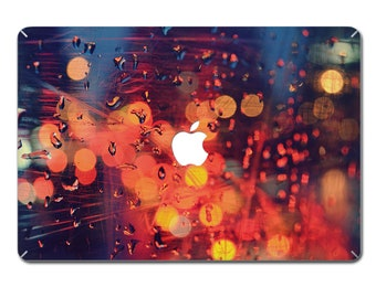 MacBook decal with a blurry light