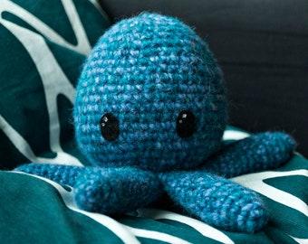 Cute crocheted blue hexapus (six-limbed octopus).