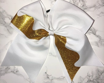 White hair bow with gold accent