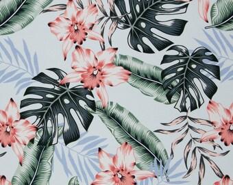 Tricot stof met tropische bladeren en bloemen