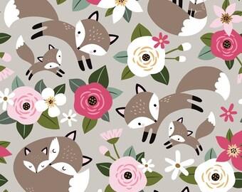 Grijze french terry stof met vossen en bloemen
