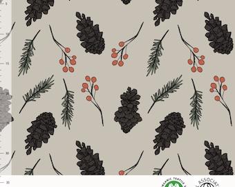 Biologische tricot stof met dennenappels en takjes. Elvelyckan Forest Desert