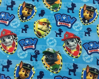 Blauwe tricot stof met Paw Patrol