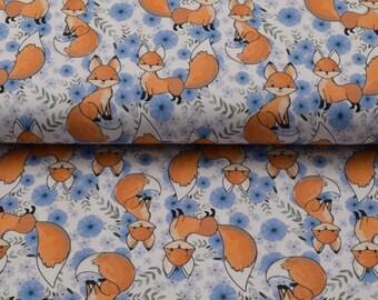 Wit en blauwe tricot stof met vossen