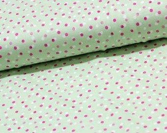 Coupon: Groene tricot stof met roze stipjes