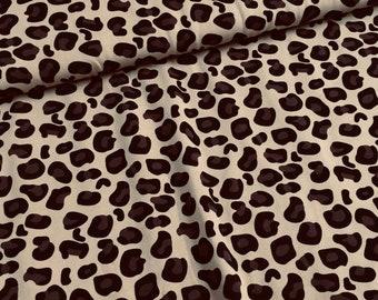 Bruine tricot stof met panter patroon
