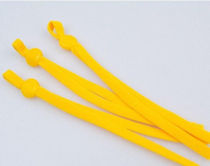 Elastiek voor mondkapjes, geel. 10 cm. 5 mm breed. Per 10 stuks