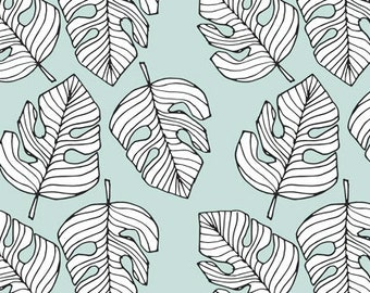 Mint green jersey fabric with monstera leaves. Elvelyckan dusty mint monstera, organic cotton