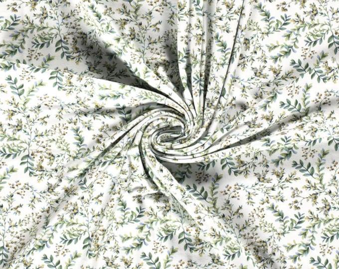 Witte tricot stof met groene blaadjes en bessen