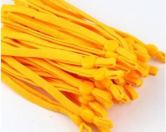Elastiek voor mondkapjes, maisgeel. 10 cm. 5 mm breed. Per 10 stuks