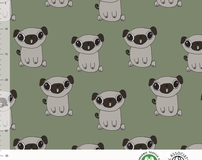 Biologische tricot stof met hondjes. Elvelyckan Pugs green