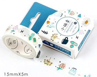 Witte washi tape met blauwe bloemetjes, kopjes en gold foil. Goud washi tape, blauw witte washi tape.