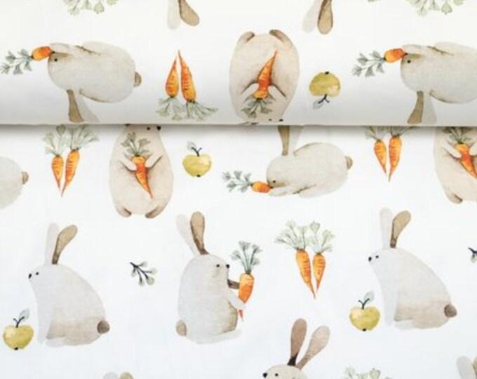 Wolwitte tricot stof met konijntjes en worteltjes