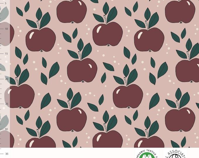 Biologische tricot stof met appels. Elvelyckan Apples Dusty Pink