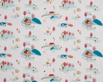 Witte tricot stof met bomen, huisjes en konijntjes