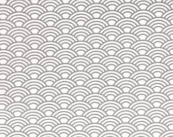 Coupon: Grijze tricot stof met golven