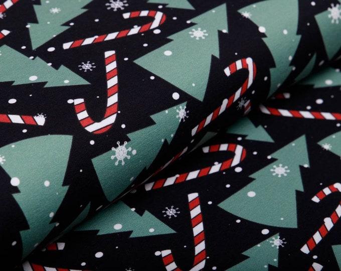 Zwarte joggingstof met kerstbomen. Swafing Frohe Weihnachten
