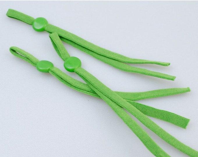Elastiek voor mondkapjes, groen. 10 cm. 5 mm breed. Per 10 stuks