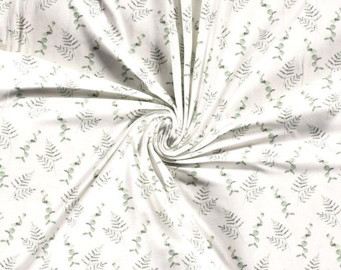 Witte tricot stof met eucalyptus  en varen takken