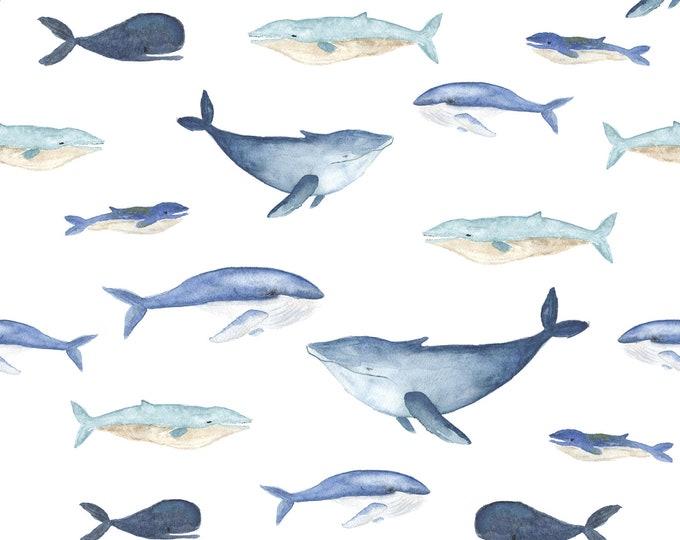 Off-white tricot stof met walvissen