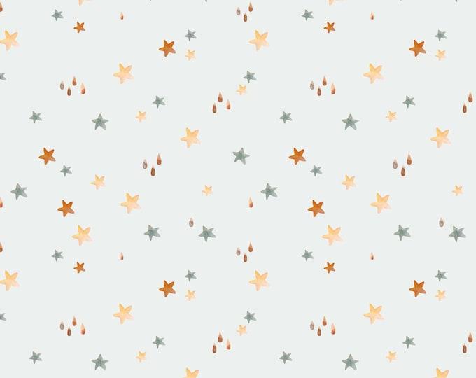 Witte tricot stof met sterretjes. Sterren stof