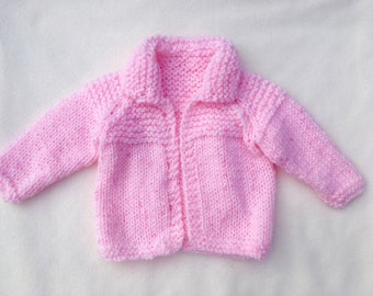 Pink hand-knit baby cardigan