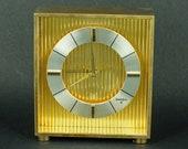 Charming alarm clock Swiza 8 days, Brass case clock, Swiss made, with Alarm