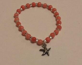 Coral Colored Charm Bracelet