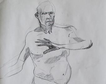 Charcoal life drawing of a man with a raised arm
