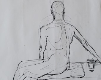 Charcoal life drawing of a man sitting with back turned
