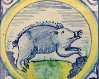 Coaster with a blue boar