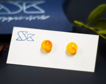 Fused glass earrings made from sunshine yellow glass.  Summery round glass stud earrings.