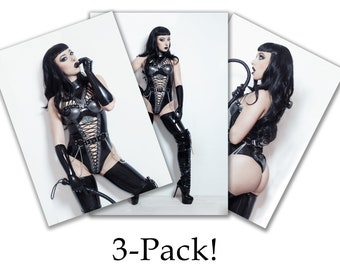 """3 PACK! 3 different photo prints of model Lotte LaVey in black latex with black """"Bettie Page"""" hair and bullwhip"""